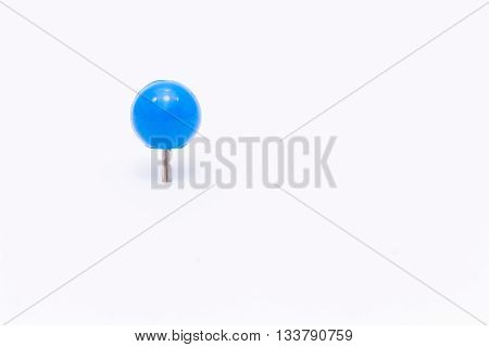 Blue push pin isolated white background.Blue push pin