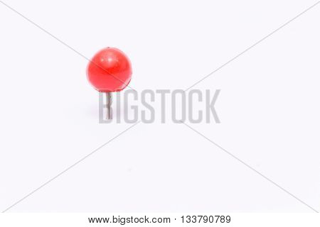 Red push pin isolated white background.Red push pin