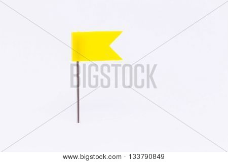 Yellow flag pin isolated white background.Yellow flag pin