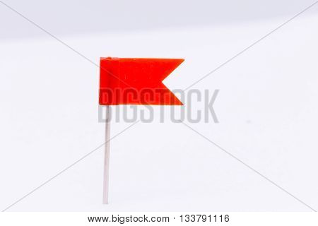 Red flag pin isolated white background.Red push pin