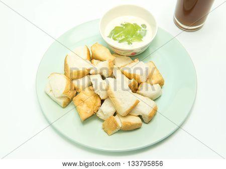 Thai dessert Slice steamed bread and pandan custard