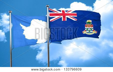antarctica flag with Cayman islands flag, 3D rendering