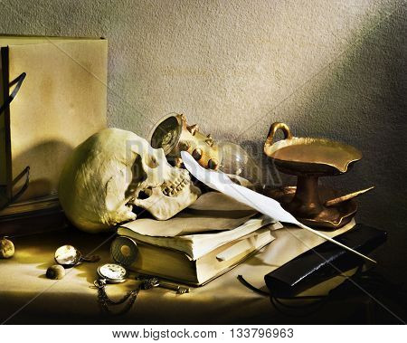 Still life with human skull vintage antique pocket watch and grunge book on wooden table,shallow Depth of Field,Focus on human skull.