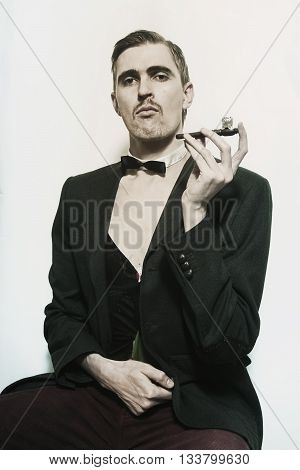 Retro portrait of an adult man smoking a pipe closeup