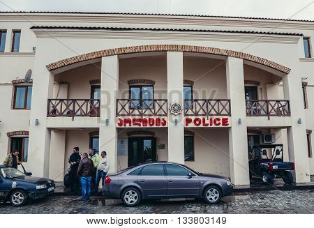Sighnaghi Georgia - April 24 2015. Group of men stands in front of police station in Sighnaghi town