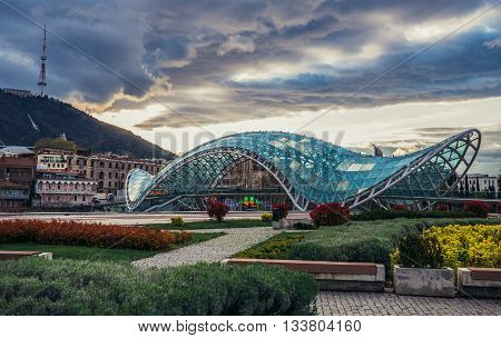 Tbilisi Georgia - April 24 2015. Modern Bridge of Peace over Kura River designed by Michele De Lucchi