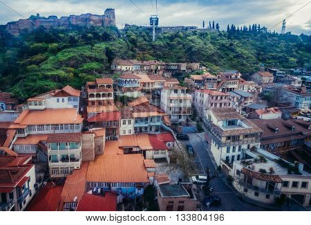 Tbilisi Georgia - April 24 2015. Aerial view on the Old Town of Tbilisi. Narikala Fortress on background