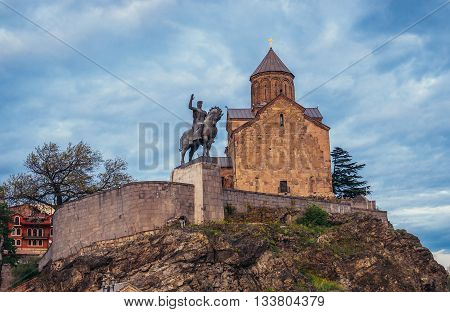 Tbilisi Georgia - April 24 2015. Church of Assumption and statue of Vakhtang I Gorgasali Wolf Head in Tbilisi
