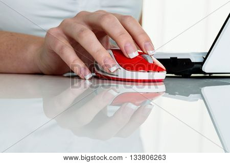 woman in office with computer mouse