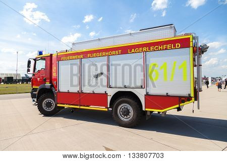 BERLIN / GERMANY - JUNE 4 2016: german fire service truck stands on airport in schoenefeld berlin / germany at june 3 2016.