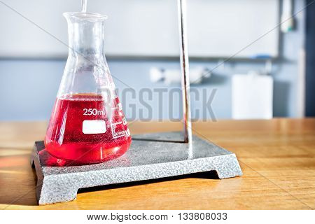 Science Equipment On The Table Including A Beaker