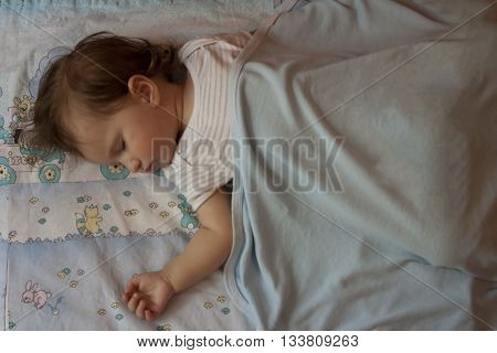 Baby being peaceful while sleeping the boredom away