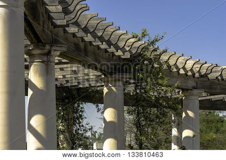 Leading lines of a pergola with blue sky background