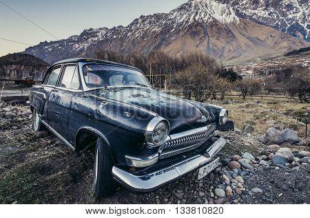 Gergeti Georgia - April 25 2015. GAZ M21 Volga car in small Gergeti village in Mtskheta-Mtianeti region