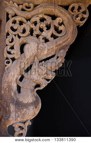 The old wood statue serpent king or king of naga in thai temple.