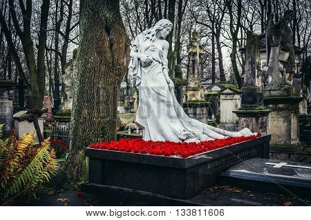 Warsaw Poland - November 29 2015. Grave statue on Old Powazki cemetery in Warsaw city