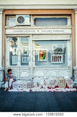 Belgrade Serbia - August 29 2015. Crochet tablecloths for sale on Prince Michael Street in Belgrade city