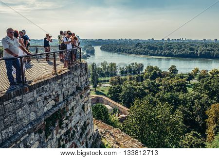 Belgrade Serbia - August 29 2015. Tourists looks at Danube River from walls of Upper City of Belgrade Fortress