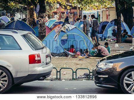 Belgrade Serbia - August 29 2015. People in a makeshift refugee camp in one of the parks in Belgrade