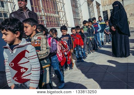 Ar Ramtha Jordan - December 23 2015. Students and teachers of primary school for Jordanians and Syrian refugees in Ar Ramtha city