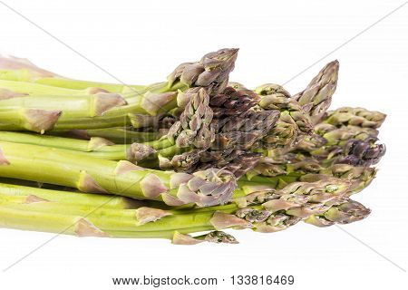 heap of green asparagus vegetables isolated on white background.