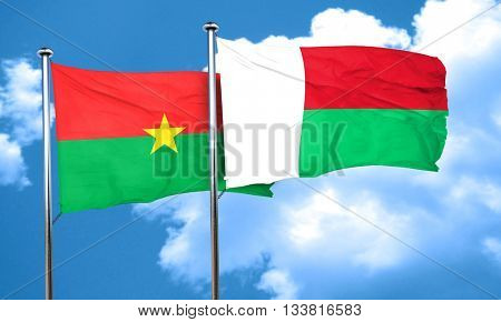 Burkina Faso flag with Madagascar flag, 3D rendering