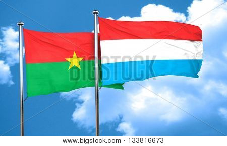 Burkina Faso flag with Luxembourg flag, 3D rendering