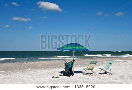 Beach Chairs with Umbrella on a Beautiful Sunny Beach in Florida