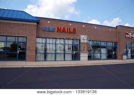 SHOREWOOD, ILLINOIS / UNITED STATES - AUGUST 16, 2015: One may have one's nails trimmed at K&K Nails in a Shorewood strip mall.
