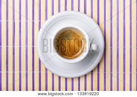 cup of coffee isolated on colored wooden placemat