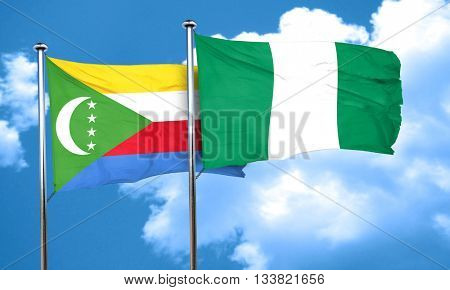 Comoros flag with Nigeria flag, 3D rendering