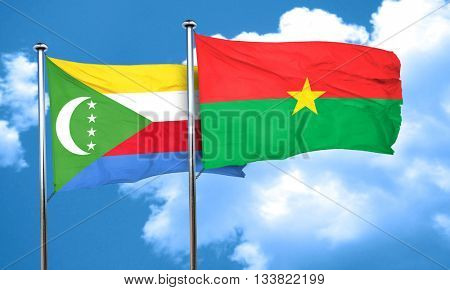 Comoros flag with Burkina Faso flag, 3D rendering