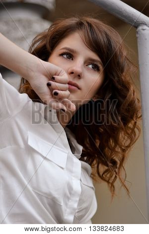 Portrait of red-haired girl. Red-haired, beautiful, attractive girl. Fashionable, cute, nice pretty girl with white, pale, light, bright skin, nice, cute face. Serious, calm, interesting, unusual look, sexy, eyesight