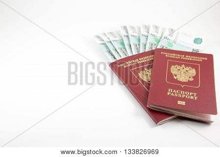 The passports of the Russian Federation and money on a white background