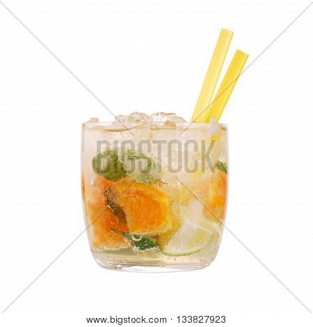 Glass of orange caipirinha with straws isolated on white