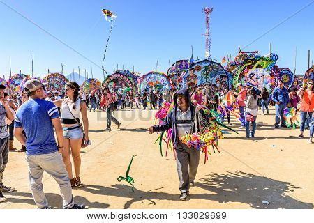 Sumpango Guatemala - November 1 2015: Visitors & toy vendor at giant kite festival on All Saints' Day honoring spirits of dead.