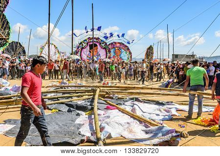 Sumpango Guatemala - November 1 2015: Wreckage of fallen giant kite on ground as visitors watch at giant kite festival on All Saints' Day honoring spirits of dead.