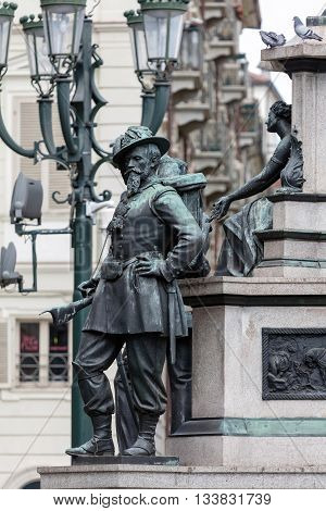 Statue of a mid-19th century Sardinian soldier at the side of the equestrian monument to the king Charles Albert of Sardinia in Piazza Carlo Alberto in Turin sculpted by Carlo Marochetti in 1861.