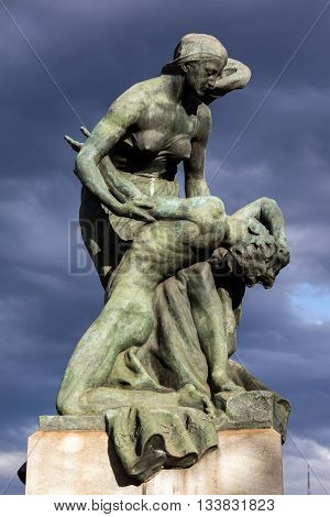 TURIN ITALY - APRIL 24 2016: Bronze statue depicting Pieta was added to the Ponte Umberto I bridge in Turin Italy by Luigi Contratti in 1911