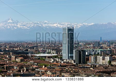 TURIN ITALY - APRIL 25 2016: Torre Intesa Sanpaolo in Turin Italy is a skyscraper as well as the headquarters for the banking group Intesa Sanpaolo. The building is the second tallest in the city.