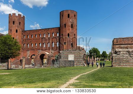 TURIN ITALY - APRIL 24 2016: The Turin's Palatine Gate gate is one of the best preserved BC Roman gateways in the world. Is is now part of the so-called Archaeological Park opened in 2006.