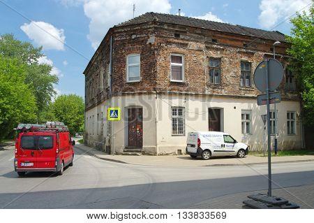 Krakow, Poland - June 04, 2016: Podgorze district, Zablocie street. Old building in an industrial area.