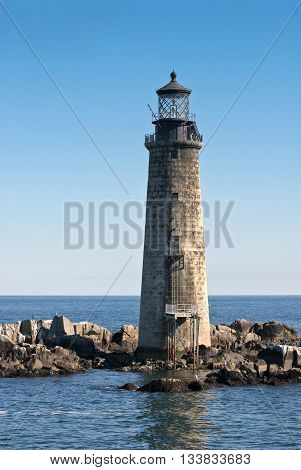 Graves Lighthouse of stone construction in Boston harbor