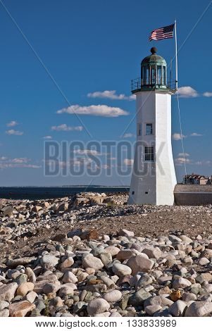 Historic Scituate lighthouse guards harbor in Massachusetts.