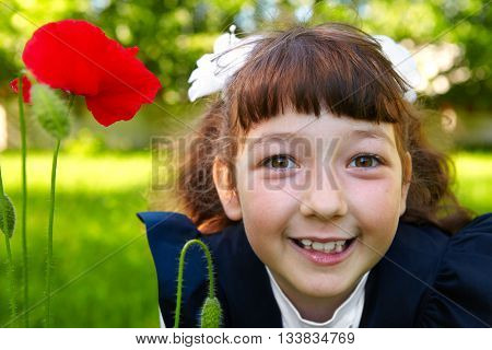 Little Girl And A Red Poppy