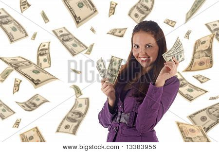 Young successful businesswoman on dollars background