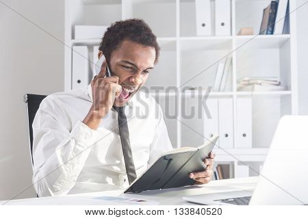 Man With Notepad Shouting