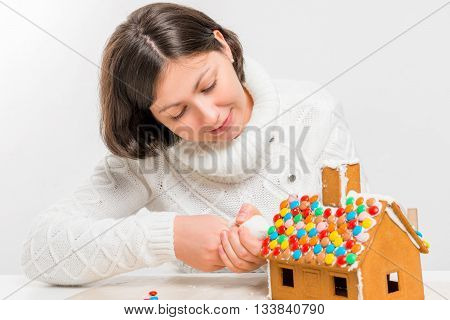 Woman Preparing Gingerbread At Home Gingerbread House