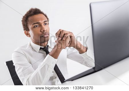 Pensive Guy Using Laptop