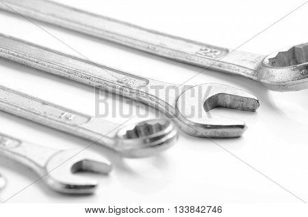 Many wrench aligned isolated on white background